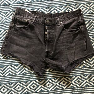 501 cut offs in faded washed black